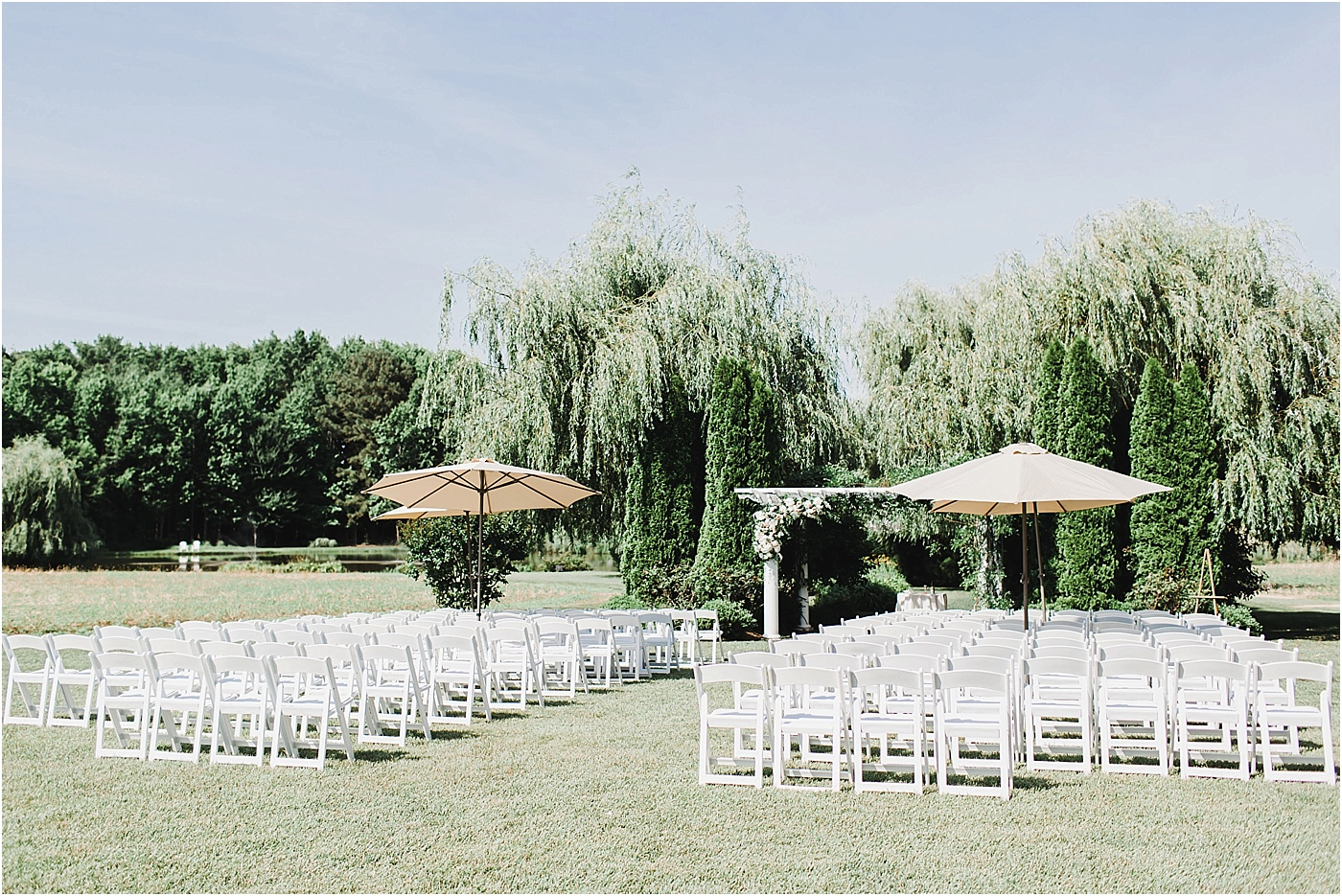 Ceremony Seating with White Chairs + Umbrellas