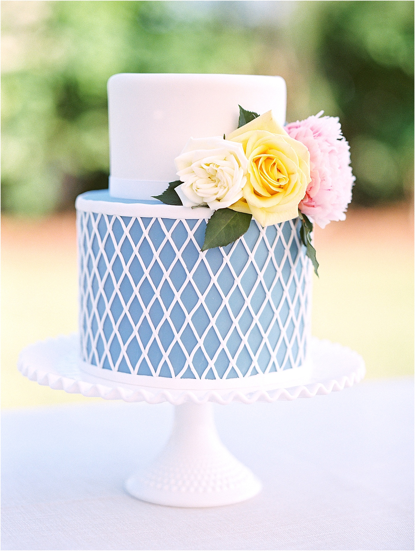 maritime blue and white floral wedding cake